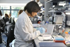A researcher works at a gene research laboratory in Italy.