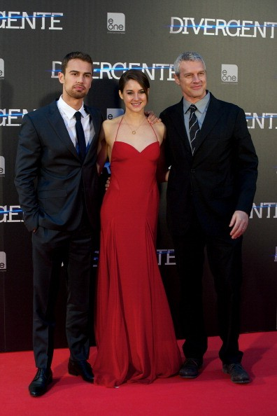 Actor Theo James, actress Shailene Woodley and director Neil Burger attend the 'Divergent' premiere at the Callao cinema on April 3, 2014 in Madrid, Spain.