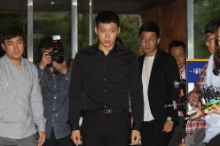 K-pop star Park Yoochun appears at police for questioning over rape allegations.
