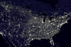 The U.S. power grid system is seen below an overview of a photo taken by satellites from space.