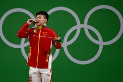 Long Qingquan of China wins the men's 56kg category of the Rio 2016 Olympic Games weightlifting events at the Riocentro in Rio de Janeiro, Brazil, Aug. 7, 2016.