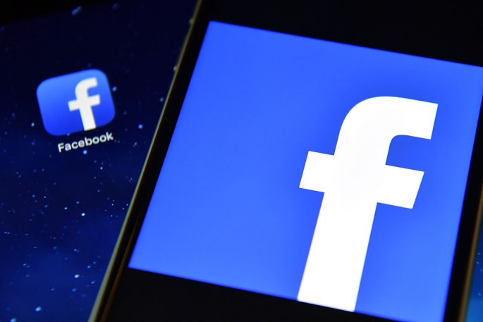 The Facebook app logo is displayed on an iPad next to a picture of the Facebook logo on an iPhone.