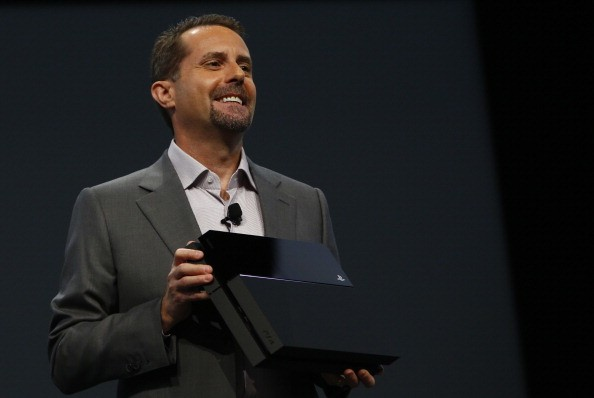 Andrew House, President and Group CEO Sony Computer Entertainment Inc., holds up a Playstation 4 at the Sony Playstation E3 2013 press conference.