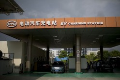 An electric car gets served at the BYD Co. EV charging station at the company's headquarters in the Pingshan district of Shenzhen.