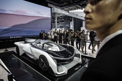 An electric vehicle (EV) sports car made by startup Faraday Future on display at the Beijing International Automotive Exhibition in Beijing in April 2016.