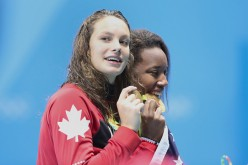 Simone Manuel of the United States who dead heated with Penny Oleksiak of Canada to both win the gold medal in the Women's 100m Freestyle Final during the swimming competition at the Olympic Aquatics Stadium Aug,11, 2016 in Rio de Janeiro, Brazil.