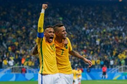 Brazil players Neymar (L) and Luan celebrate their quarterfinals win over Colombia in the 2016 Rio Olympics.