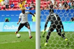 Germany winger Serge Gnabry (#17) shoots the ball against Portugal goalkeeper Varela Bruno.