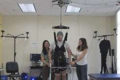 A paraplegic man is able to walk again after undergroing a brain-robot program that helps cure paralysis.