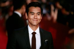 Eddie Peng poses for a picture on the red carpet at The 18th Shanghai International Film Festival on June 13, 2015 in Shanghai, China.