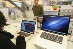 Apple MacBook Pro displayed at retail outlets for sale.