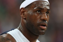 LeBron James, during his last stint with Team USA, looks on during the gold medal game in the London Olympics.