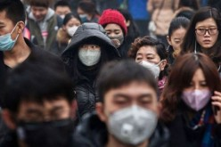 Chinese wearing cloth masks as protection against air pollution.