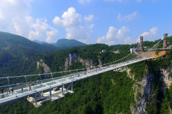 An aerial photo shows tourists visiting the glass-bottom bridge at Zhangjiajie Grand Canyon on Saturday.