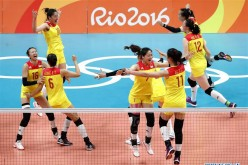 China's players celebrate after the women's gold medal match of Volleyball against Serbia at the 2016 Rio Olympic Games in Rio de Janeiro, Brazil, on Aug. 20, 2016. China won the gold medal.