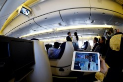 Chinese passengers may soon be able to use smartphones aboard commercial flights.