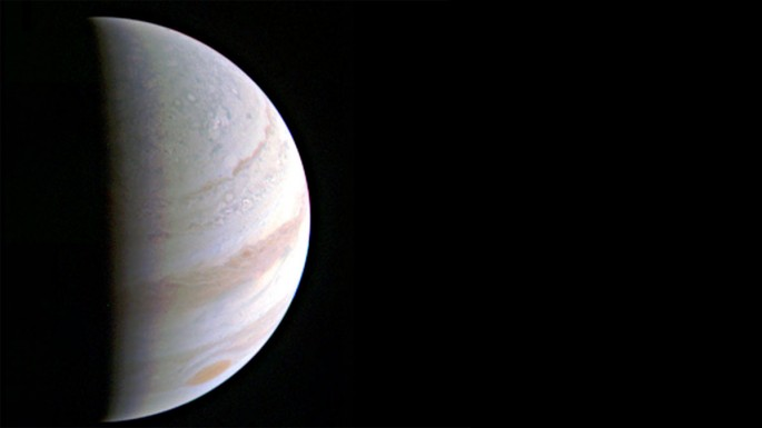 Jupiter's north polar region comes into view as NASA's Juno spacecraft approaches the giant planet. This view of Jupiter was taken on Aug. 27, when Juno was 703,000 kilometers away.