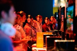 Gamers and show attendees play video games at the XBOX 360 booth during the Electronic Entertainment Expo on June 7, 2011 in Los Angeles, California.