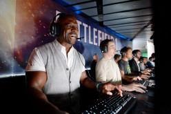 Actor Terry Crews plays the video game 'Battlefield 1' after a Electronics Arts news conference on June 12, 2016 in Los Angeles, California.