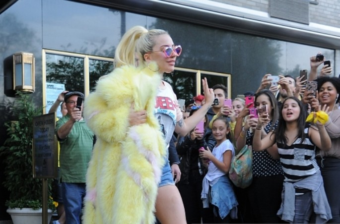 Lady Gaga wears short shorts and a large fur coat steps out in Manhattan on May 11, 2016 in New York, New York.