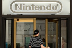 A man enters Nintendo's flagship store, July 11, 2016 in New York City. Nintendo NX console is rumored to be announced in October