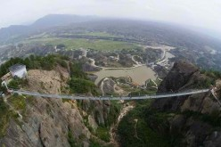 Hunan's glass bridge draws more than 10,000 tourists a day.