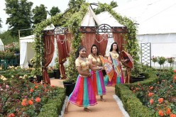 Bollywood style dancers perform in the Fryer'd Roses garden during the launch of the RHS Hampton Court Flower Show at Hampton Court Palace on July 4, 2016 in London, England.