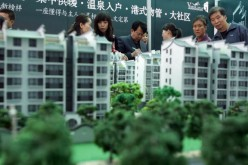Visitors view architects' models of apartment blocks during the 2007 Xian Autumn Real Estate Trade Fair on Oct. 26, 2007 in Xian of Shaanxi Province, China.