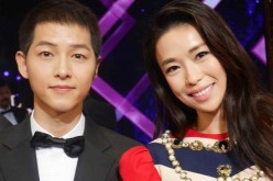 Singapore actress Rebecca Lim shares a photograph with South Korean star Song Joong Ki at the 2016 Seoul International Drama Awards.