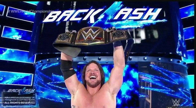 A.J. Styles celebrates after winning the WWE World Championship at Backlash.