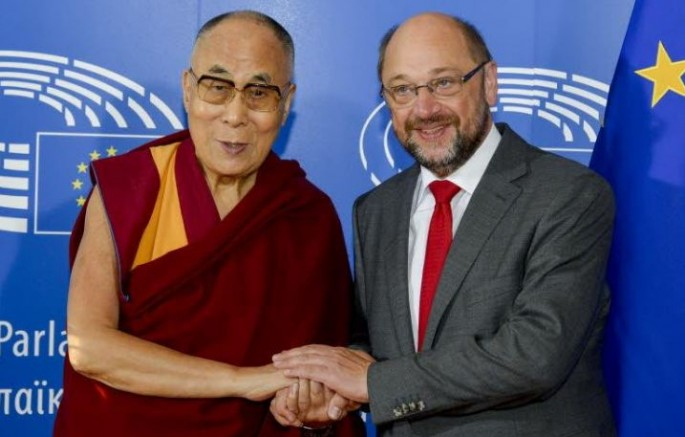 The Dalai Lama is welcomed by European Parliament president Martin Schulz at his arrival at the European Parliament.