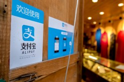 A clothes shop in Lijiang, Yunnan Province, displays a signboard telling customers that it accepts payments through Alipay.
