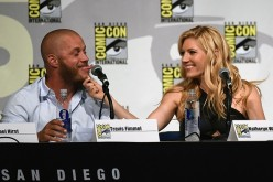 Katheryn Winnick pulls on actor Travis Fimmel's beard as they joke around during a panel for the History series 'Vikings' during Comic-Con International 2015 at the San Diego Convention Center on July 10, 2015 in San Diego, California.