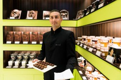 A casino employee shows a tray of chocolates in a casino resort in Macau.