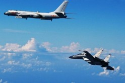 A PLAAF H-6K strategic bomber and an Su-30MKK long-range fighter on the Miyako Strait patrol.