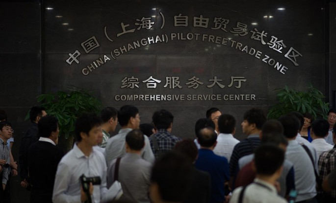 People mill around the comprehensive service center at Shanghai Free Trade Zone.