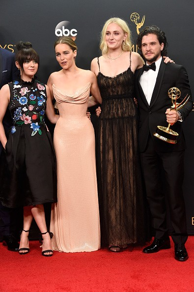 (L-R) Actors Maisie Williams, Emilia Clarke, Sophie Turner and Kit Harington, winners of Best Drama Series for 'Game of Thrones', pose in the press room during the 68th Annual Primetime Emmy Awards.