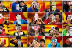 People take pictures of themselves in Tian'anmen Square as they celebrate the National Day marking the 67th anniversary of the founding of the People's Republic of China, in Beijing on Oct. 1, 2016.