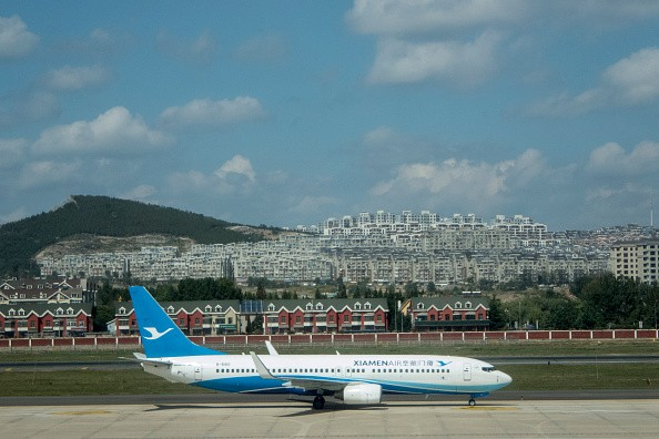 A Boeing 737 of Xiamen Airlines is parked at Dalian Airport.