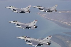 Republic of Singapore Air Force F-16Cs and an F-16D in formation.