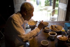 Zheng Xuechu, born in 1910, has dinner at his home in Taizhou city, East China's Zhejiang province, on June 21, 2011.