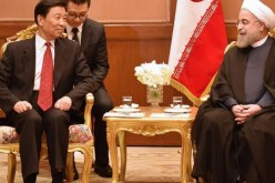Iranian President Hassan Rouhani meets with Chinese Vice President Li Yuanchao.