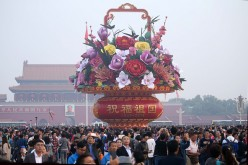 Chinese celebrate the National Day on Oct. 1.