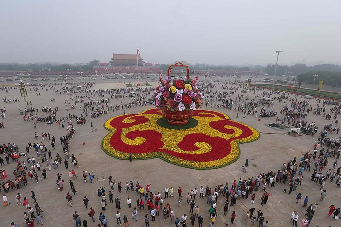 "Center of attraction: This photo taken on Sept. 25, 2016, shows a huge ""flower basket"" decoration resting on Tiananmen Square, aiming to charm tourists celebrating the National Day on Oct. 1."