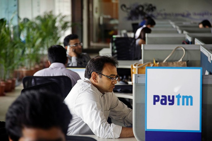 Employees work at the One97 Communications Ltd. headquarters in Noida, Uttar Pradesh, India. One97 operates PayTM.