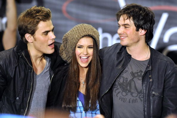 Paul Wesley, Nina Dubrev and Ian Somerhalder pose for a picture at 'The Vampire Diaries' Hot Topic tour at the Westfield Topanga Mall on February 13, 2010 in Canoga Park, California.