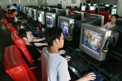 Chinese gamers play online computer games at an Internet cafe in Shanghai.