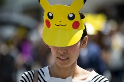 A woman wearing a Pikachu shaped sun visor arrives for the Pikachu Outbreak event hosted by The Pokemon Co. on August 7, 2016 in Yokohama, Japan.