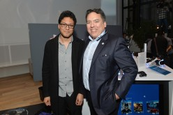 Shawn Layden, president of Sony Interactive Entertainment America, sells the first PlayStation VR system to a lucky fan.
