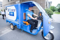 ZTO Express chairman Lai Meisong rides to personally deliver goods during the 2016 Global Smart Logistic Summit in June 2016 in Hangzhou, Zhejiang Province.